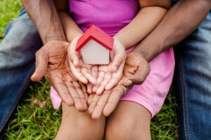 girl holding bird house